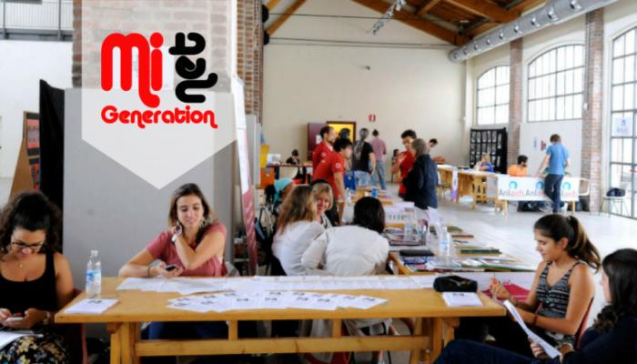 Tavoli alla Fabbrica del Vapore con logo MiGeneration Net